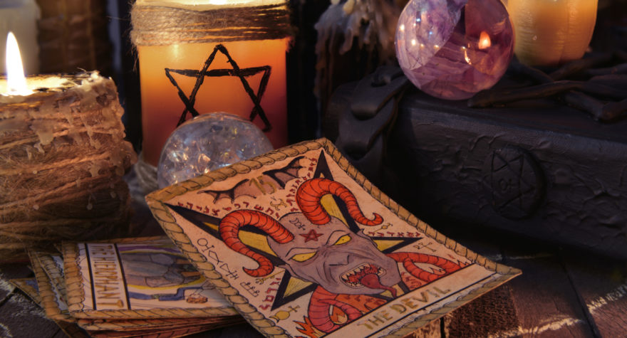 Still life with tarot cards, magic crystals and candles